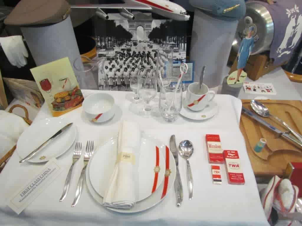 A display showcases the items that would have been used on flights in the 1950's.