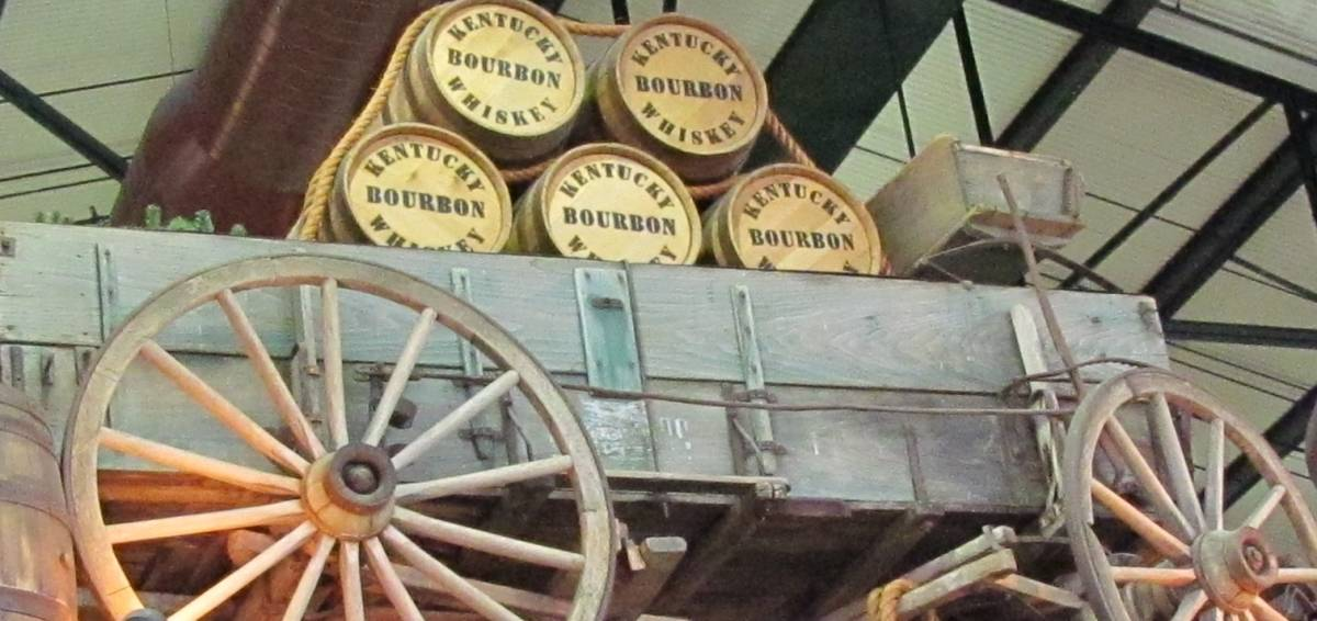Wooden barrels of bourbon are secured to an old wagon in a display at the Arabia Steamboat Museum.