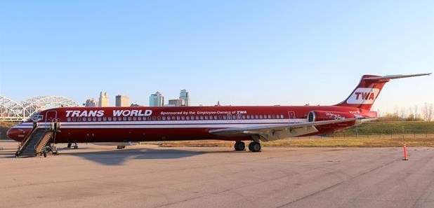 The red and white airplane is a reverse color scheme to the standard TWA airliners.