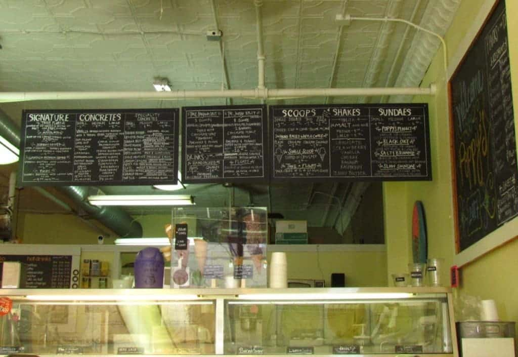 Three large chalkboards are used for the menu, and hang above the glass cases containing the ice cream.