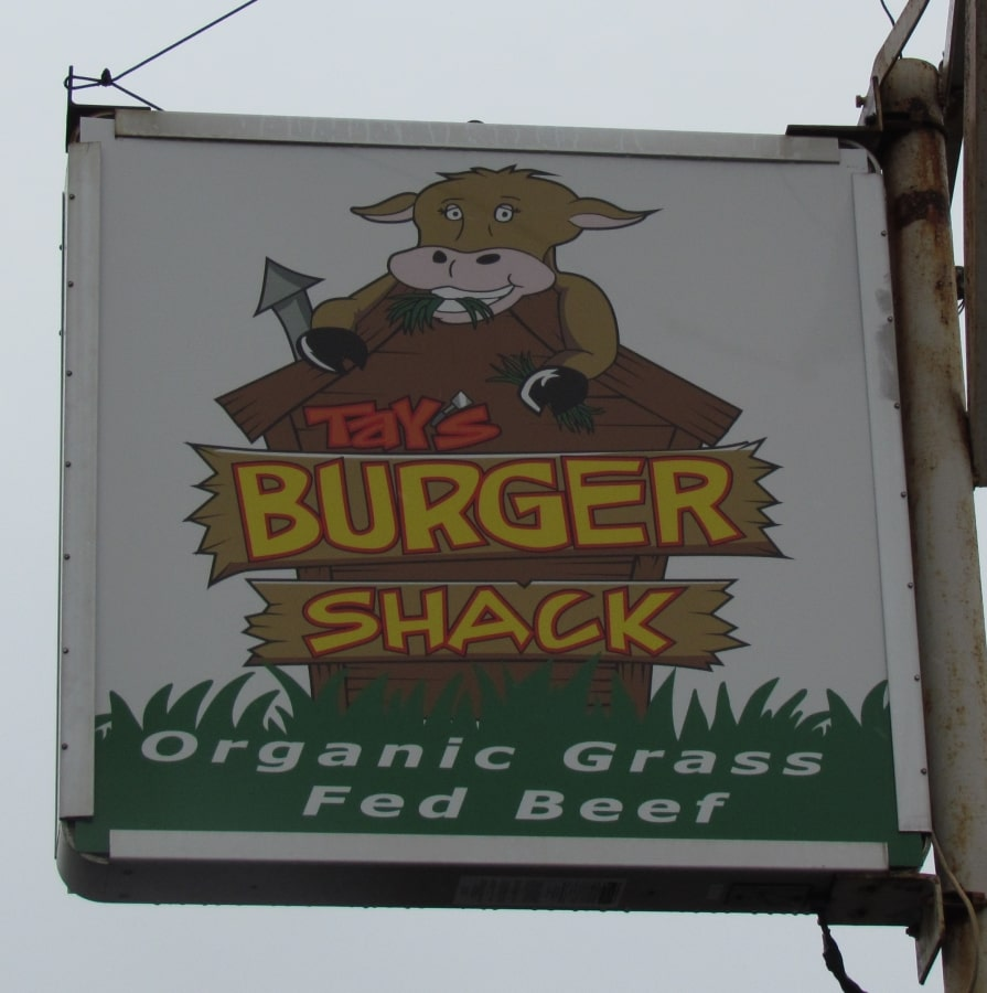 The sign signals customers that they have arrived at Tay's Burger Sack in North kansas City, Missouri.