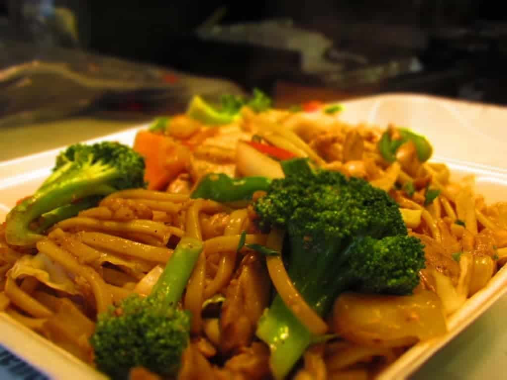 Lo mein noodles are cooked to tender perfection, and served with lots of vegetables. These include broccoli, carrots, onion, water chestnut slices, and diced peppers.