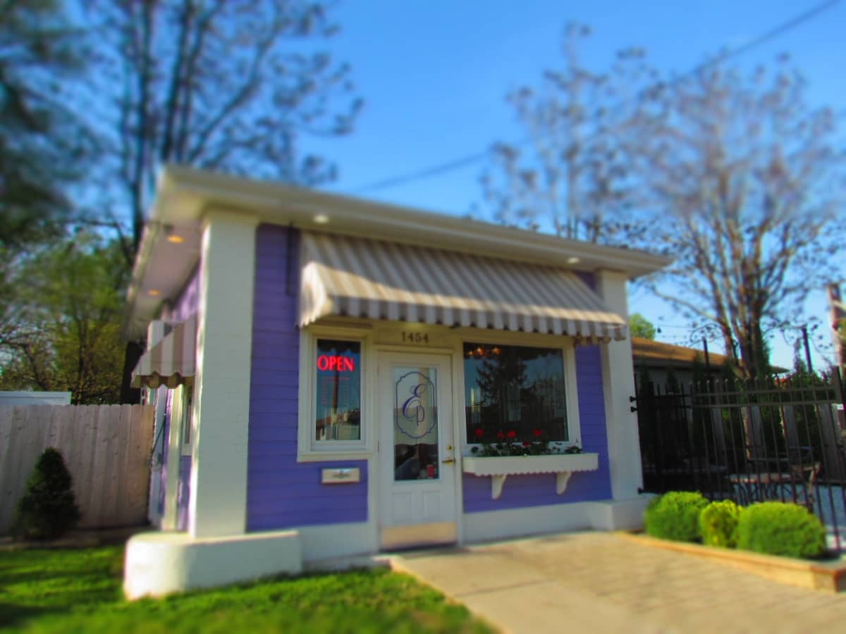 The purple building is home to Elle's Patisserie.