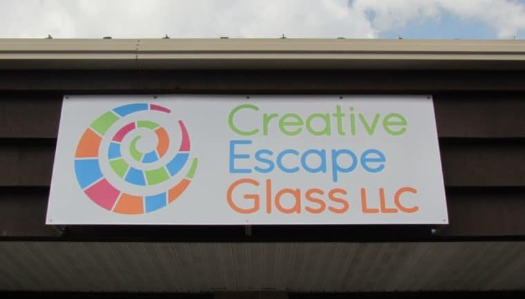 Creative Escape Glass signage.