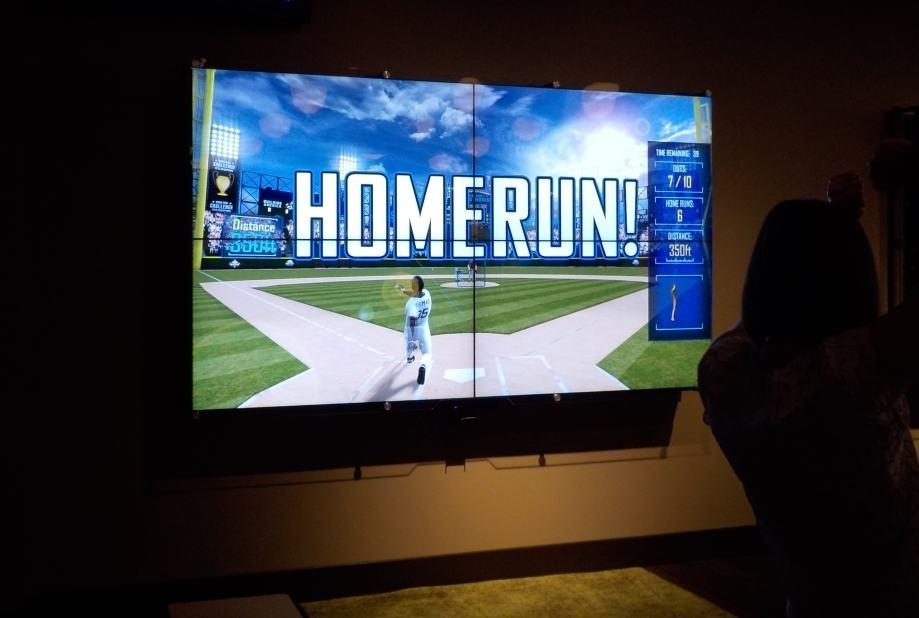 Baseball simulator signals a homerun.
