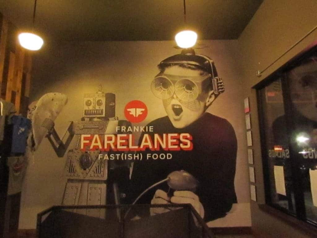 Funky graphics containing a childs robotic toy, as well as a kid in 1960's space gear adorn the wall of Frankie Farelanes restaurant.