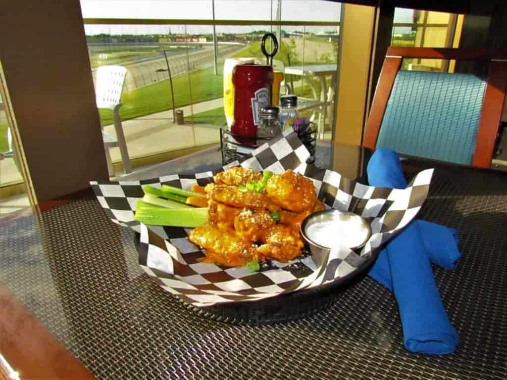 Chicken wings on a table near Kansas Speedway.