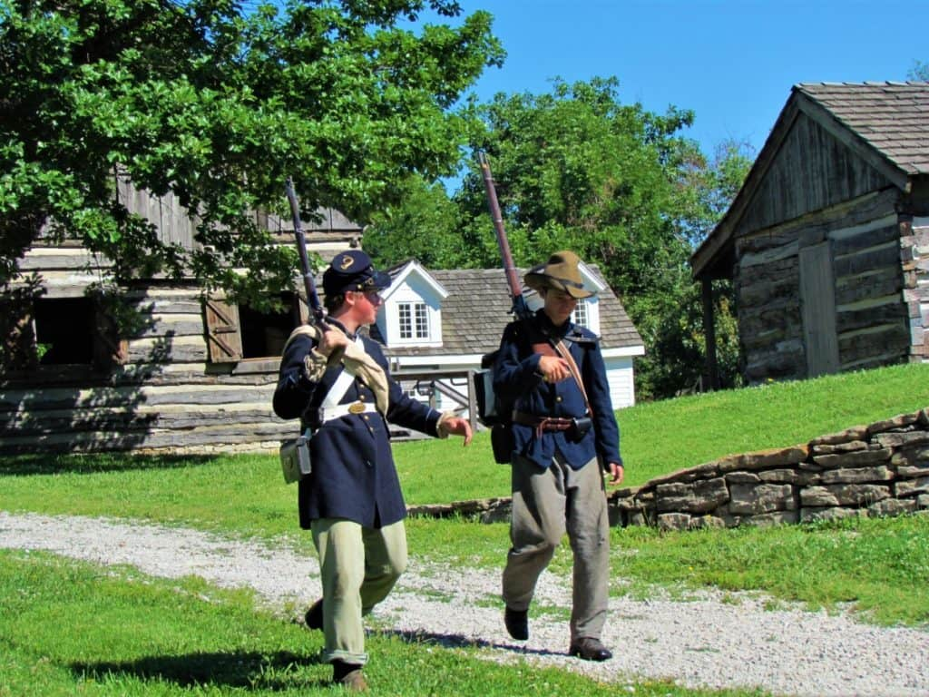 Two Union soldiers walk down the main street.