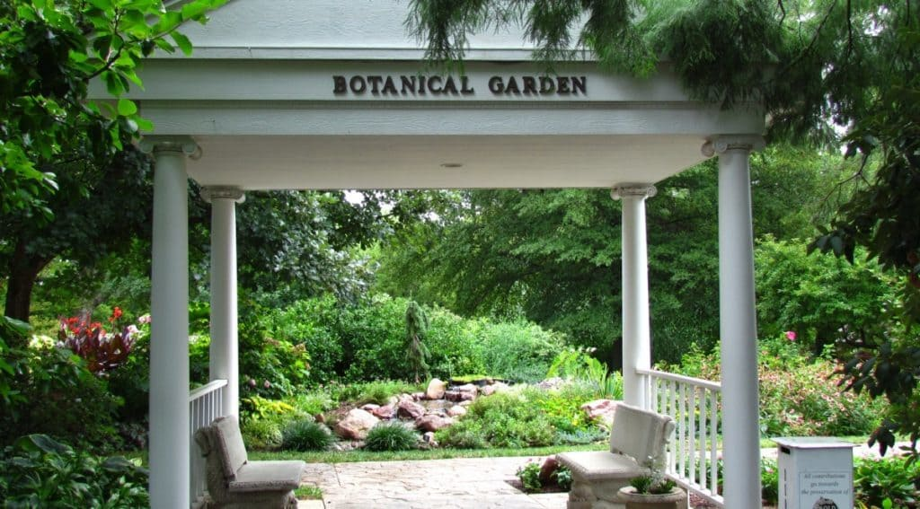 A sturdy gazebo marks the entrance to the botanical gardens.