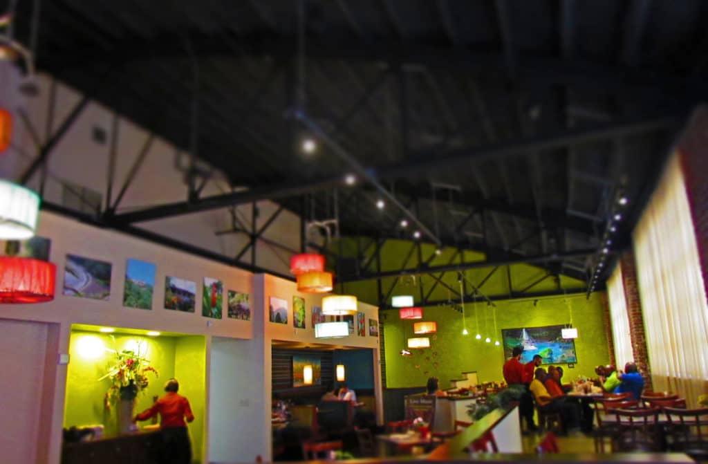 Pictures of Caribbean islands adorn the walls of Sisserou's Caribbean Restaurant.
