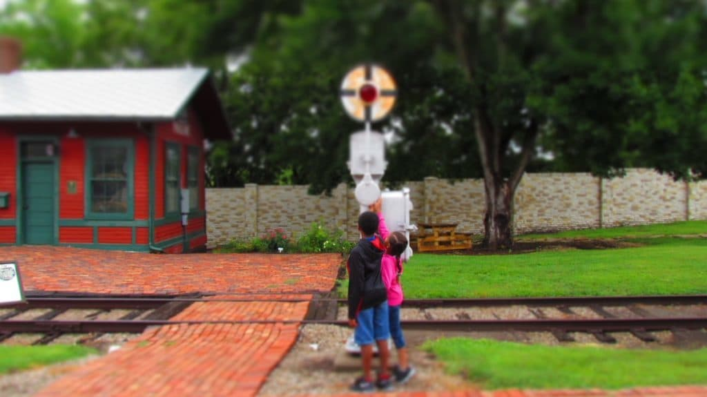 Our grand-kids inspecting a railroad signal.