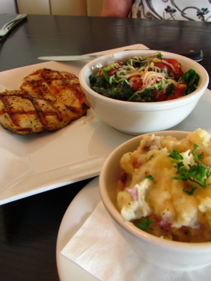 Grilled chicken dinner at Mason Jar comes with roasted garlic Gouda mashed potatoes.