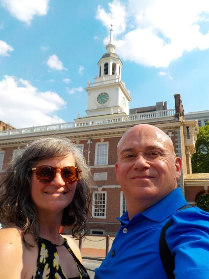 The authors pose in front of Independence Hall in Philadelphia, Pennsylvania.