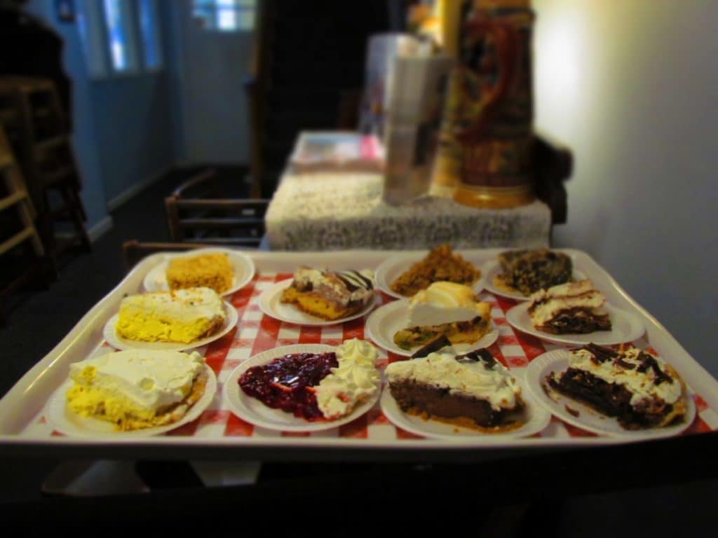 A dessert tray is filled with slices of fruit and cream pies available at Ox Yoke Inn.