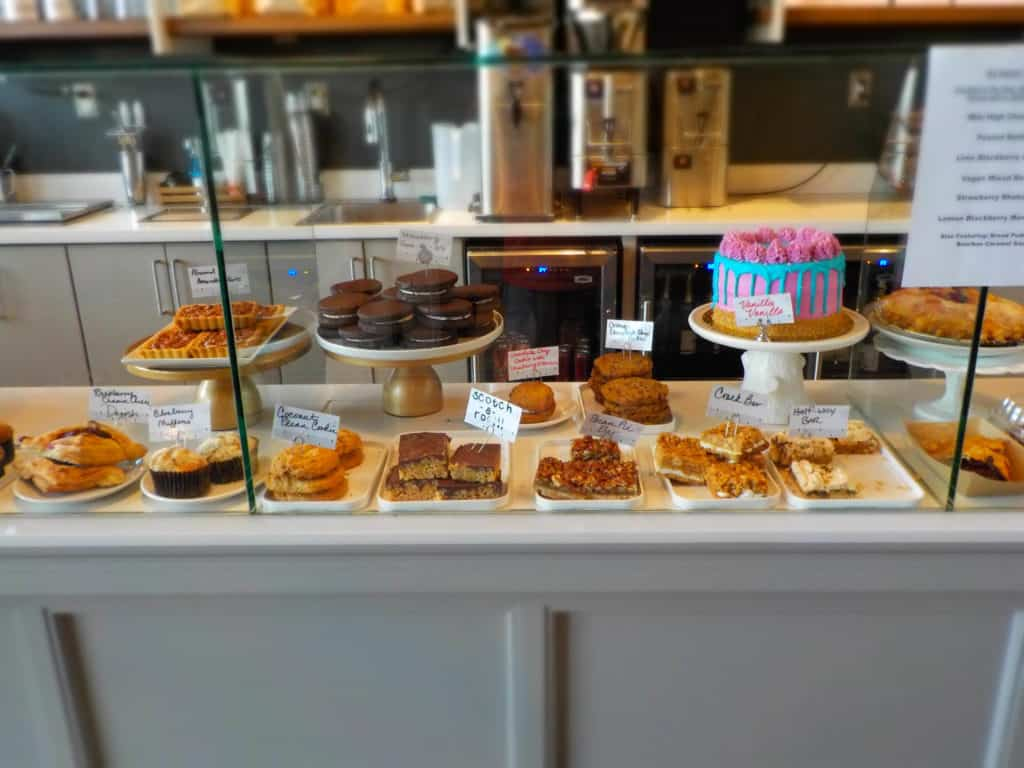 An assortment of cakes, pies, cookies, and other pastries can be found at Antoinette Baking Company.