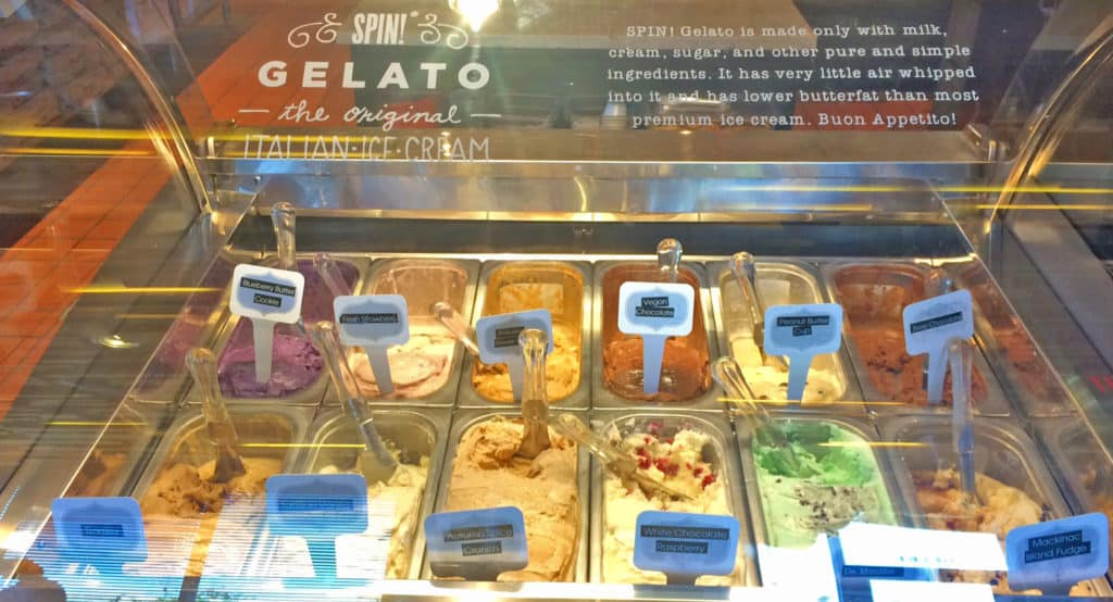 A display case filled with various flavors of gelato.