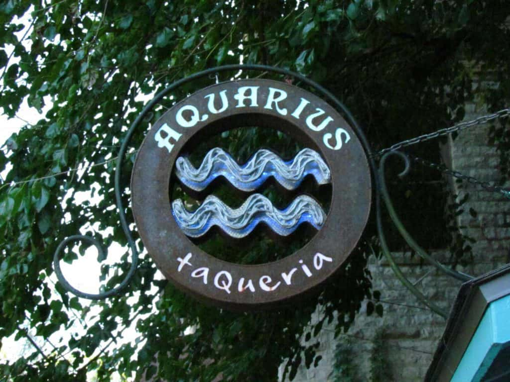 A metal sign denotes the location of Aquarius Taqueria.