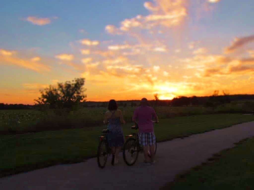 Authors taking in a beautiful Iowa sunset during a bike ride.