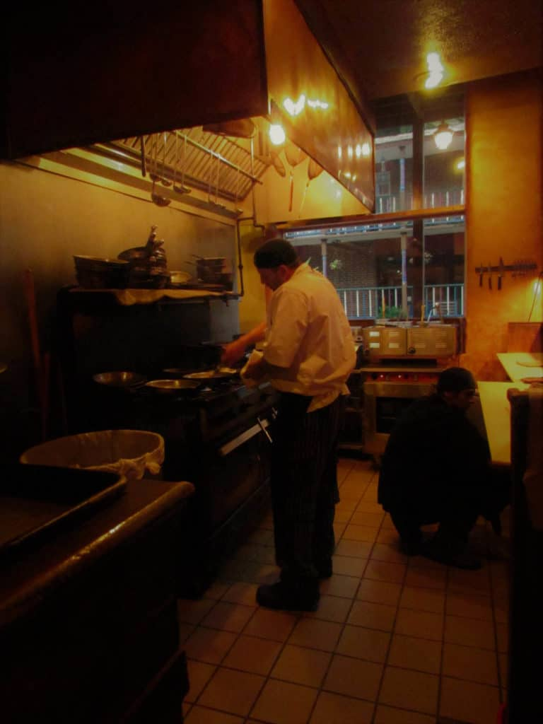 Chef Jeff Clements works his culinary magic in the kitchen of the Grand Taverne Restaurant.