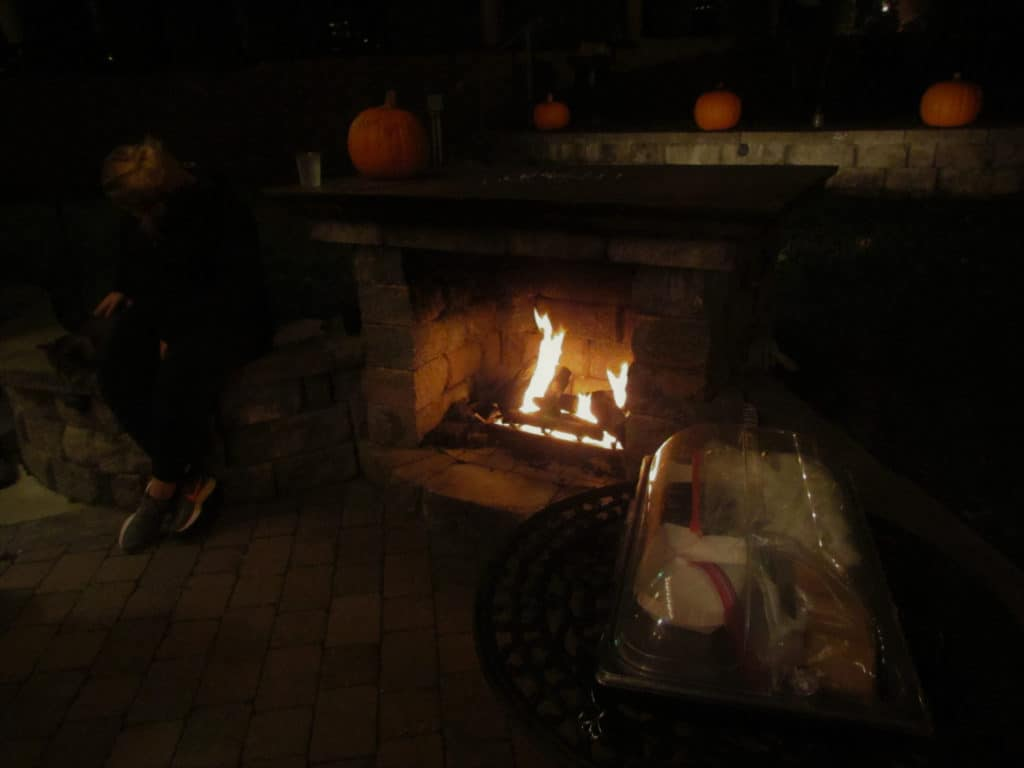The outdoor patio features an inviting fire pit for making 'mores.