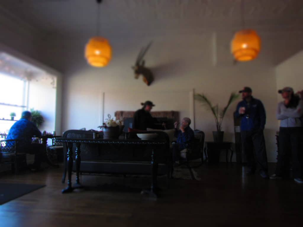 Customers relax around the modern fireplace in a seating area at Third Space Coffee.