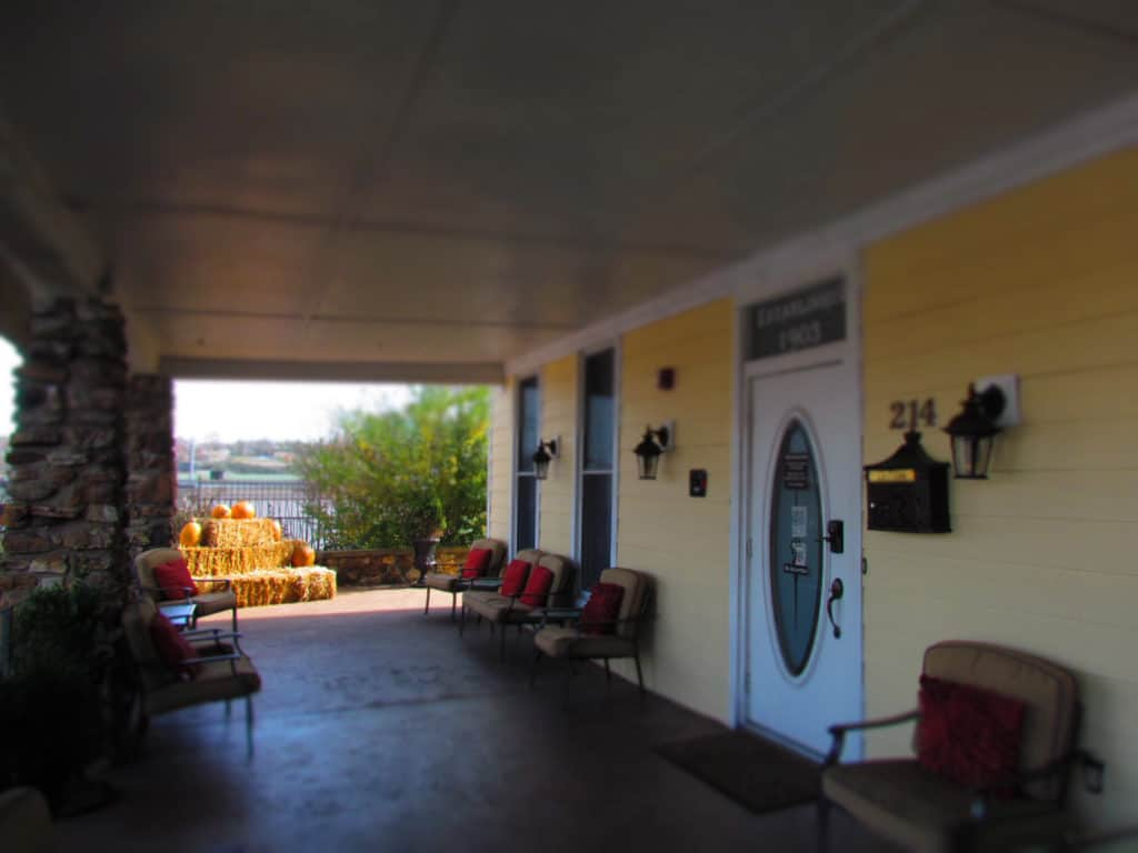 The front porch of The Branson Hotel has plenty of comfortable seating for guests to use.