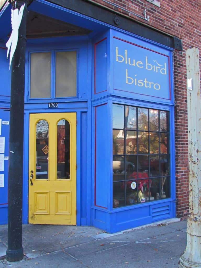 The gold door marks the entrance to the Blue Bird Bistro in Kansas City.
