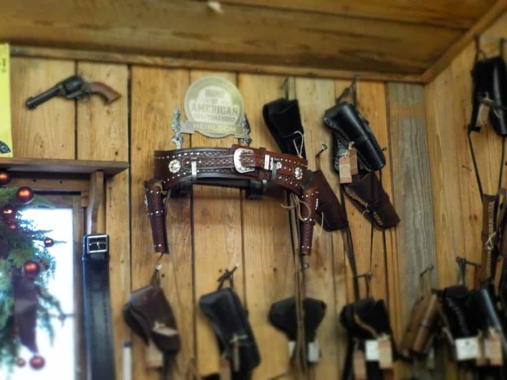 The leather shop has a wide variety of goods for sale.