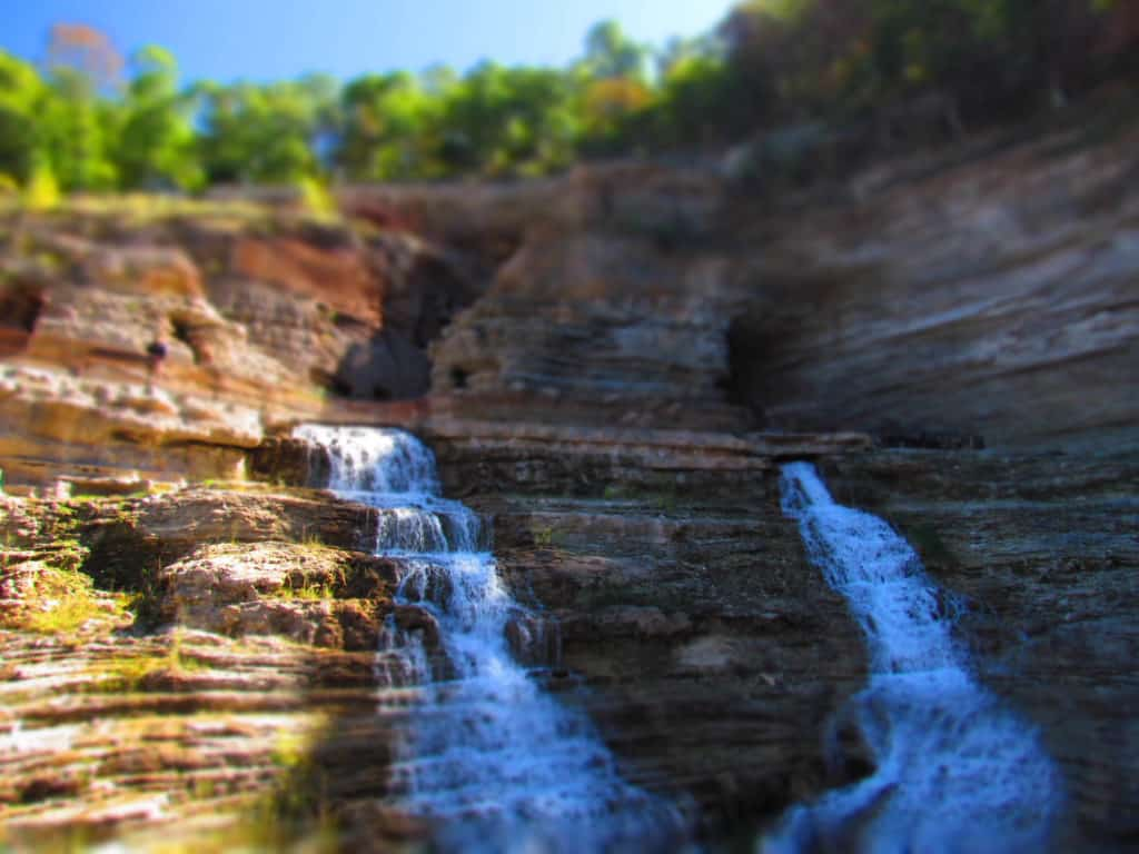A pair of waterfalls cascade down the cliffs at Top of the Rock.
