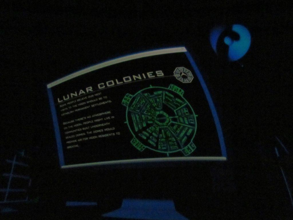 Lunar colonies are discussed during a planetarium show.