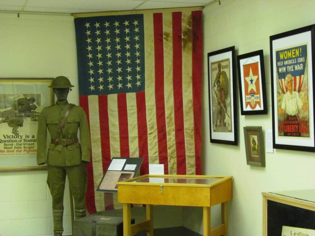 A conference room holds additional artifacts including items from World War 1.