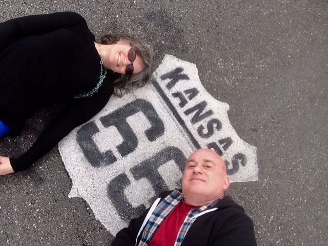The authors pose for a selfie, while lying on part of Route 66.