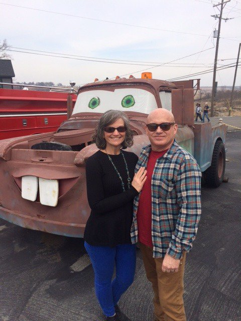 The authors pose in front of an inspiration from the movie Cars.