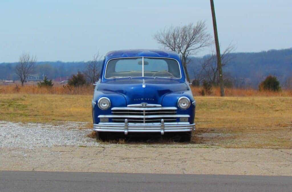 A classic car sits idly by the side of the road in Galena, Kansas.