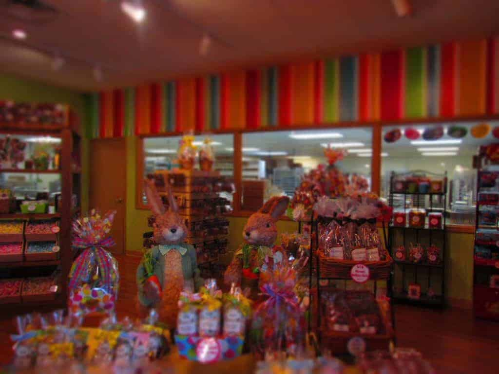 Bunnies keep watch over the candy display in the showroom.