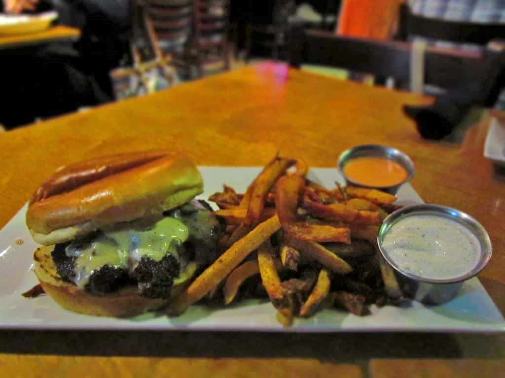 The Mushroom-Swiss Burger is a juicy delight, especially when paired with fresh cooked fries.