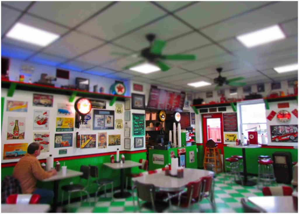 Even the seating at Filling Station BBQ reminds customers of a retro diner.