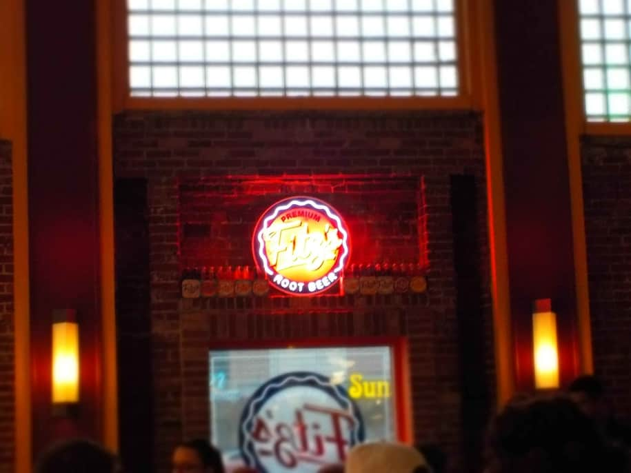 The Fitz's neon light shines brightly in the interior of the restaurant.