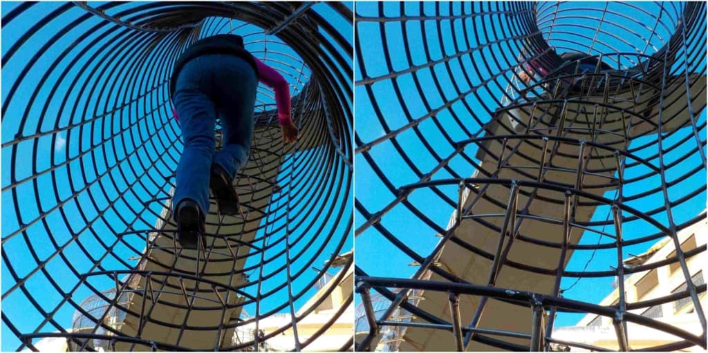 A series of tubes made of welded steel rods create tunnels for guests to travel.