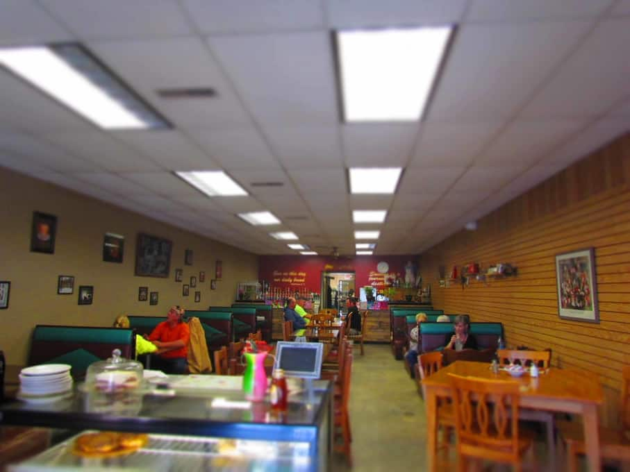 The interior of Chris' Cafe is filled with local memories and comfortable seating.