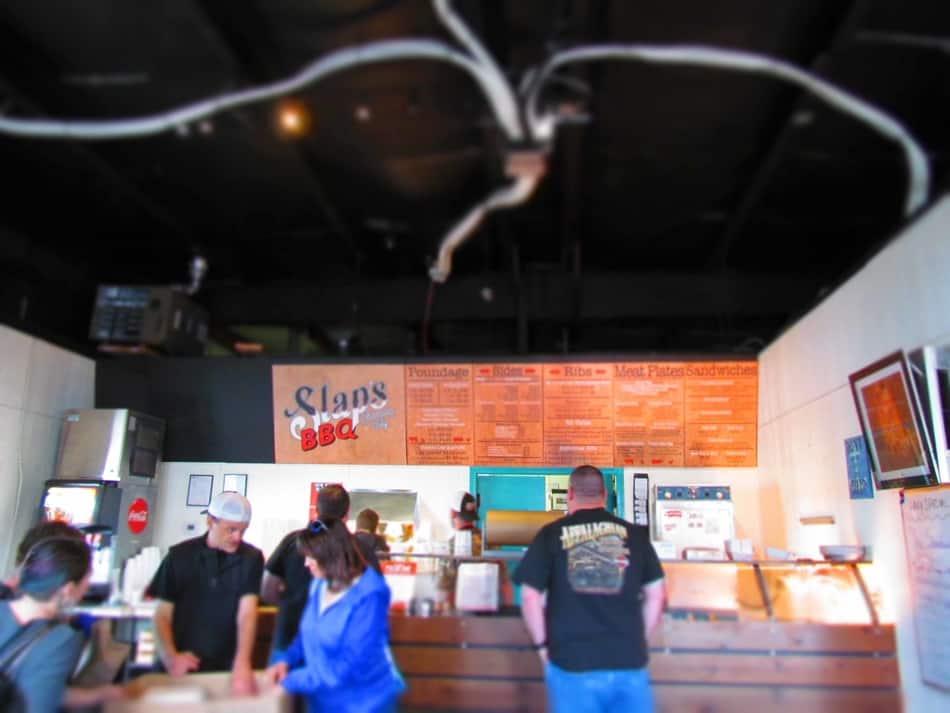 A customer waits to order at SLAP's BBQ in Kansas City, Kansas.