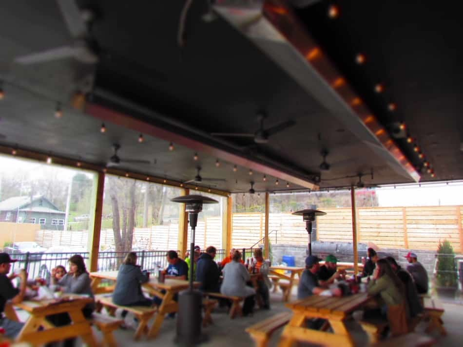 Customers brave the cool temperatures to dine outside on the covered patio.