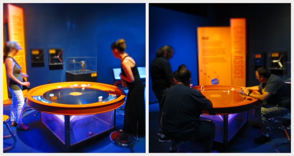 A spinning table is used to demonstrate how centrifugal force affects the travel of planets through the solar system.