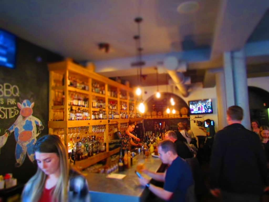 The bar area at Salt and Smoke is a popular place for whiskey drinkers.