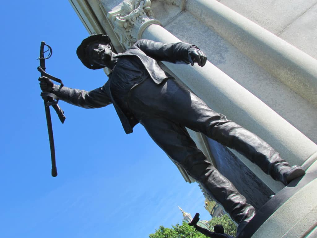 A statue on the Iowa capitol grounds has the same feeling of celebration as we do when we find a great restaurant.