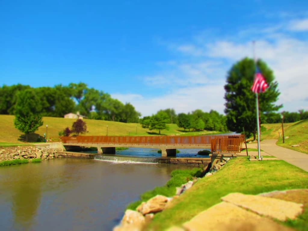 A walking bridge makes crossing the Neosho River easier than it was for wagon trains in the 1800's.