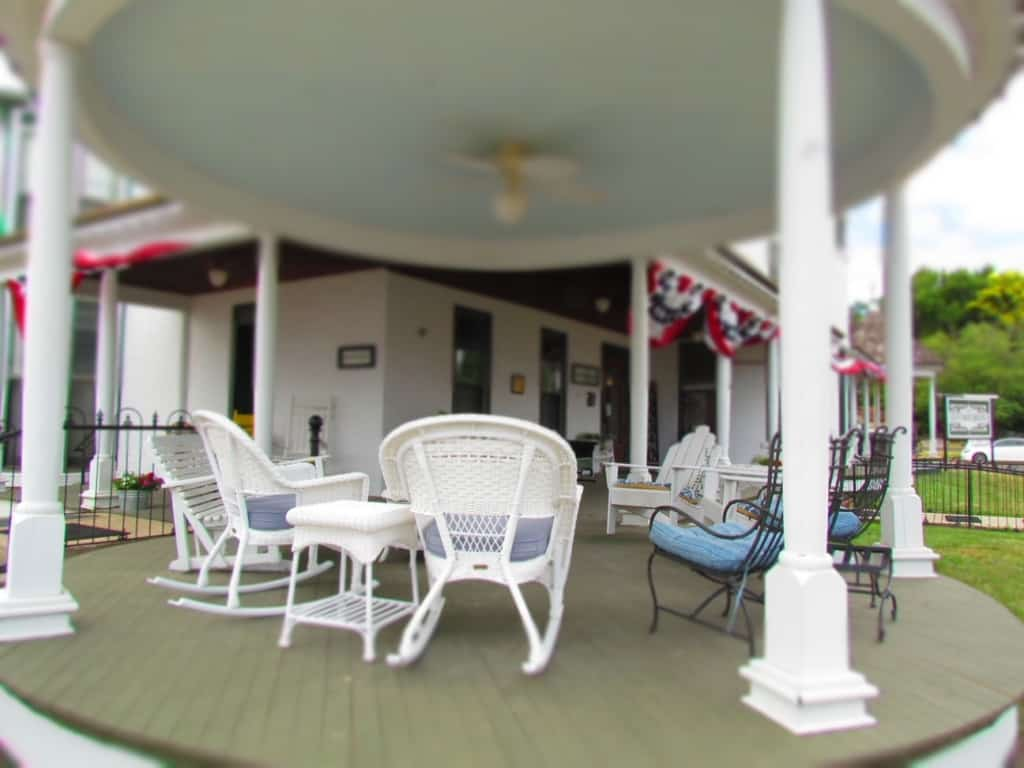 A huge covered porch offers plenty of seating at the Cottage House in Council Grove, Kansas.
