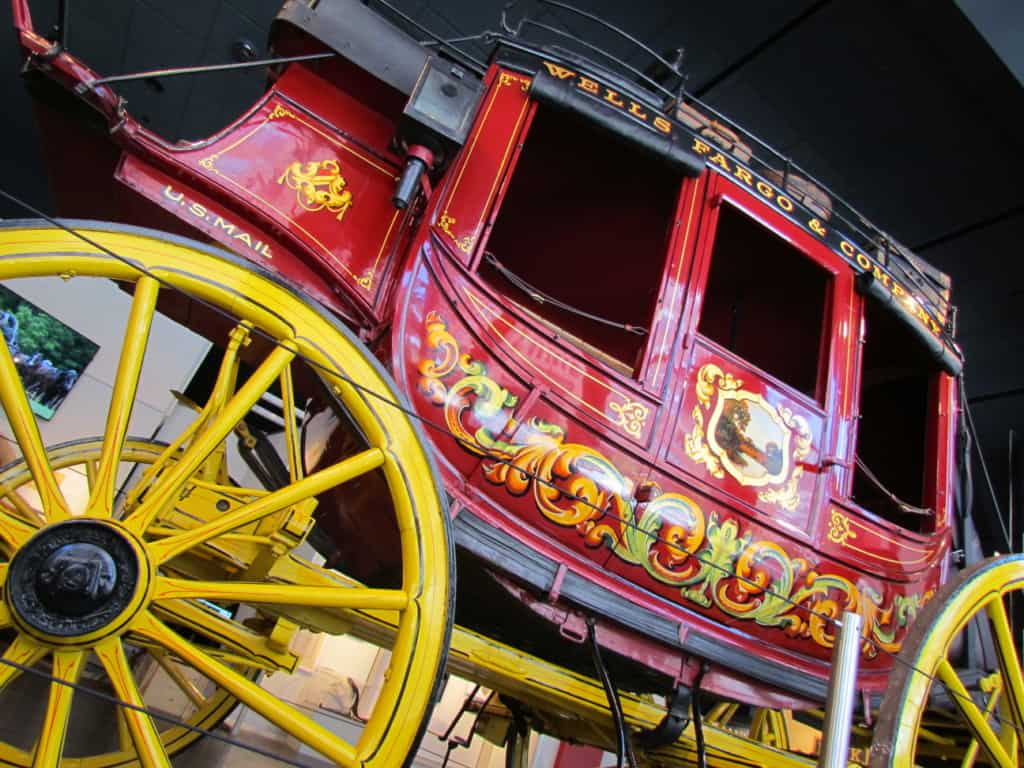 The familiar red and gold color scheme signifies this stagecoach is owned by Wells Fargo.