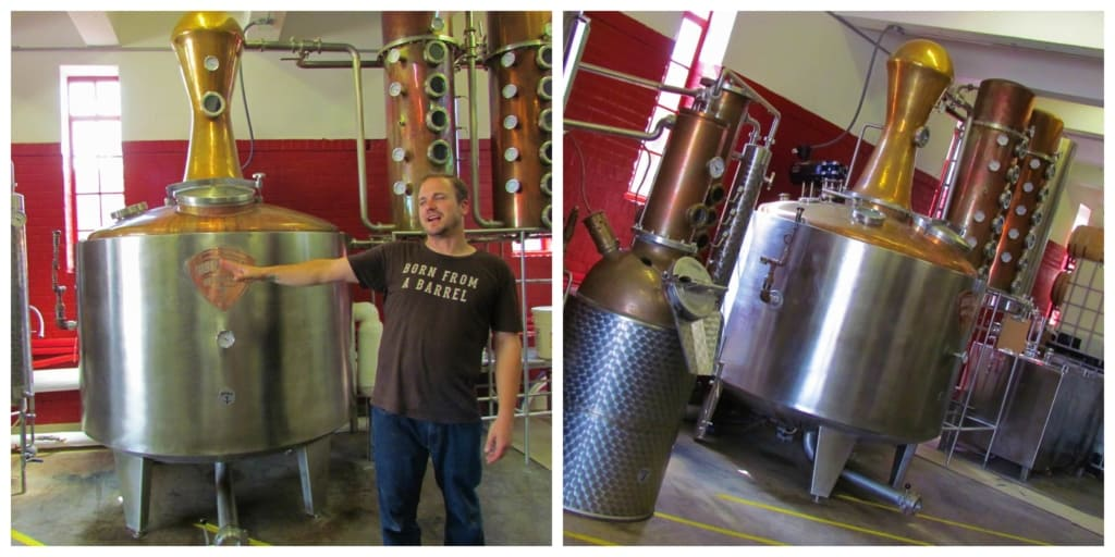 Our tour guide shows off the large still used to create their whiskey.