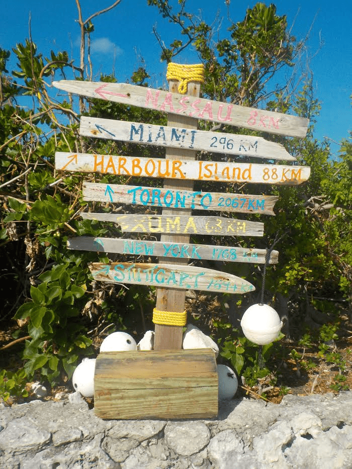 A sign shows that you are miles from you cares, when visiting Pearl Island.